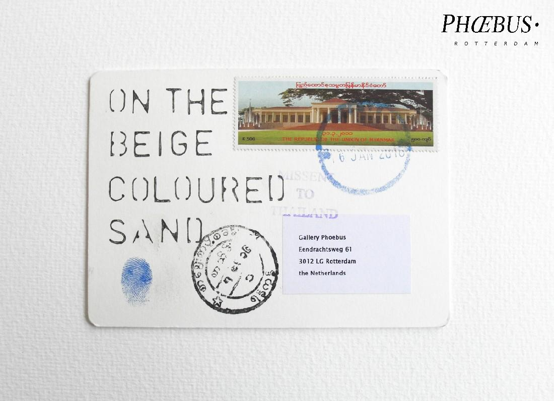 Rabin Huissen, uit de reeks: 'Postcards, 14/12/15 - 26/01/16', Thailand, Myanmar, Japan,10,4 x 14,8 cm. [on the beige coloured sand] PHŒBUS•Rotterdam
